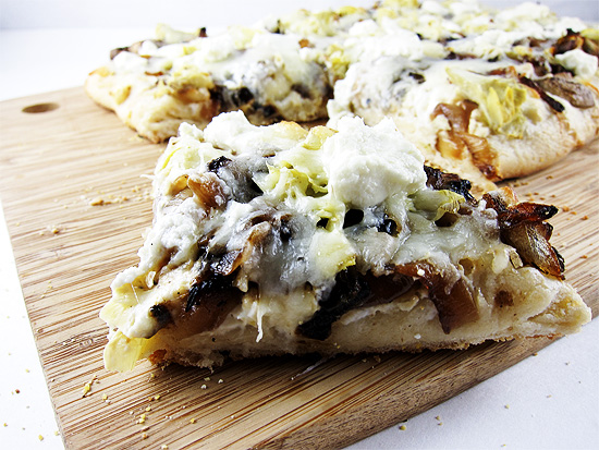 pizza with roasted garlic sauce, caramelized onion, mushrooms and artichokes