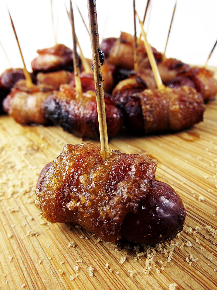 A tasty little morsel with spicy brown sugar bacon wrapped around a lil smokie. Pure bliss on a toothpick.