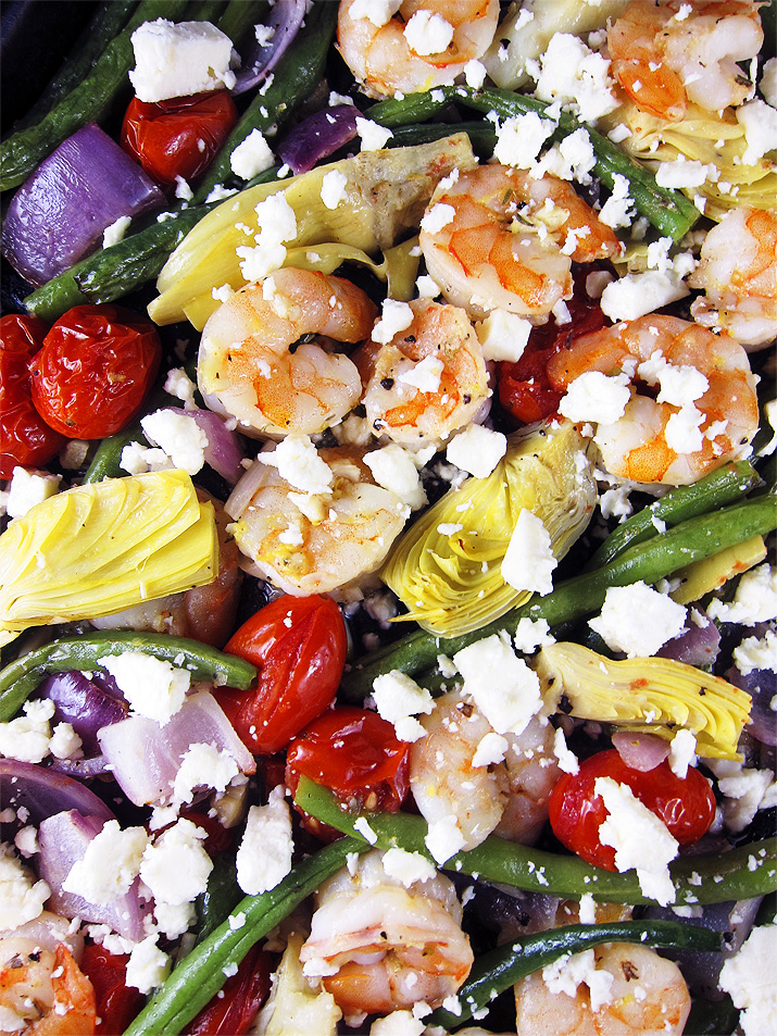 This one sheet pan dinner is full of tender, succulent shrimp and plenty of good for you veggies, like artichokes, green beans, tomatoes and more.